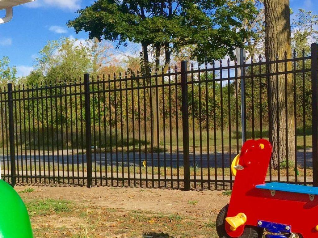 Metal fence around park