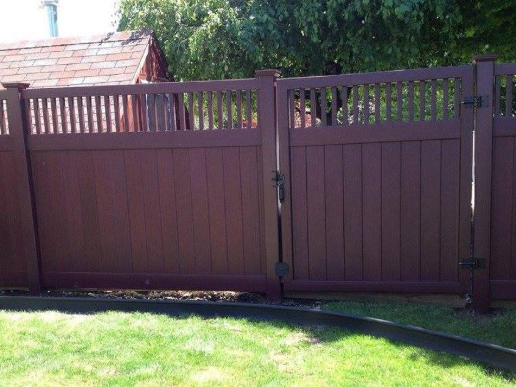 Maroon vinyl privacy fence